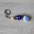 Porte clés garçon de perles de verre.